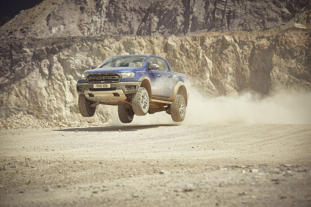 Content 2018 ford ranger raptor wildtrak shot9 34frontdynamic jump 01