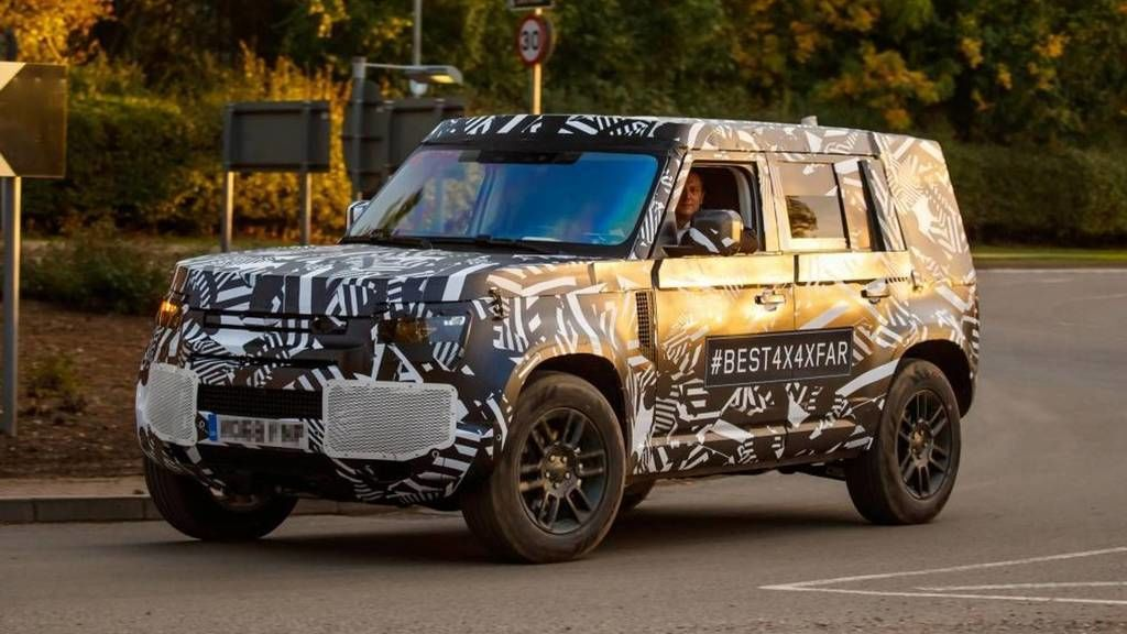 Content land rover defender zboku