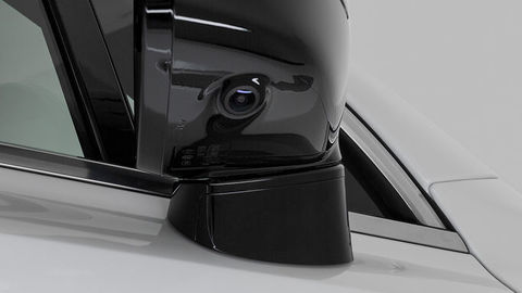 Thumb side mirror with camera