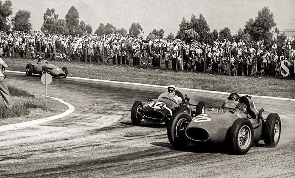Content mike hawthorn in the ferrari 246 f1 duels with the cooper climax of stirling moss