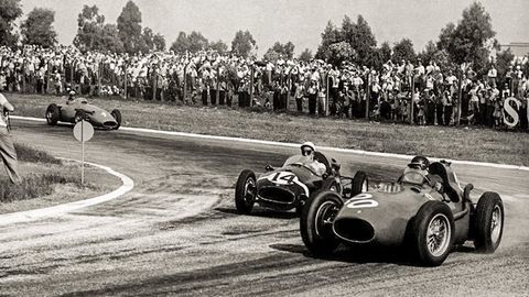 Thumb mike hawthorn in the ferrari 246 f1 duels with the cooper climax of stirling moss