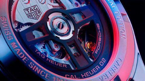 Thumb tag heuer carrera porsche chronograph caseback