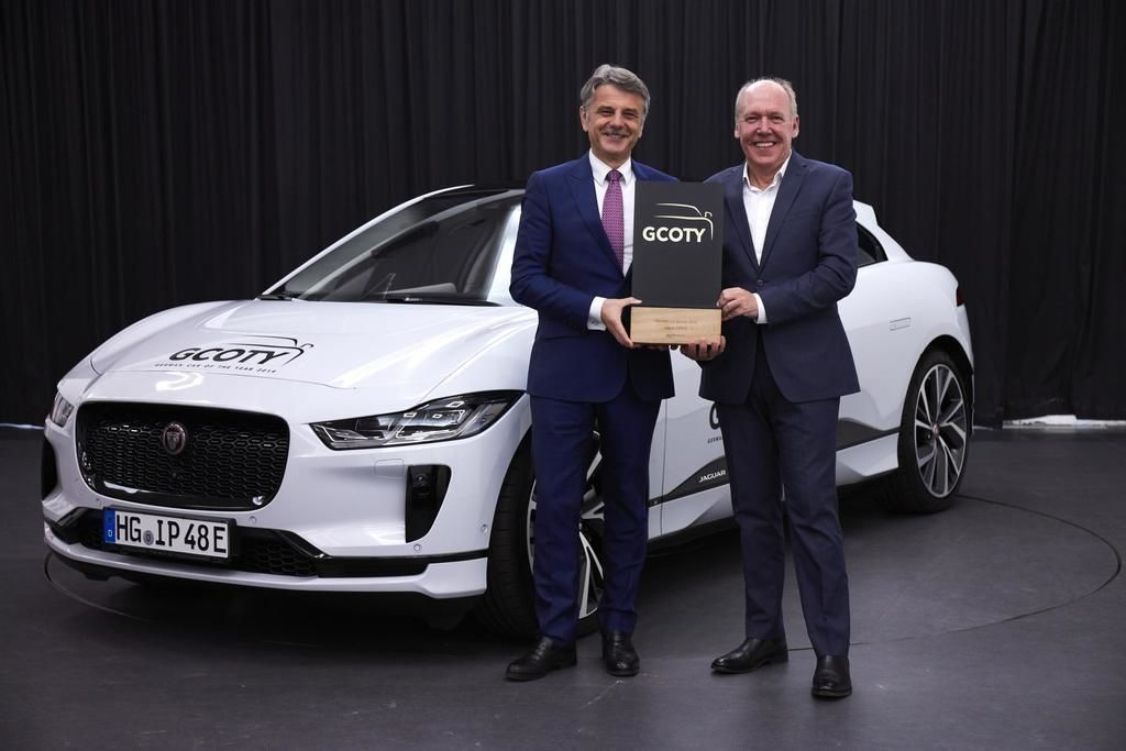 Content g coty dr. ralf speth  jaguar land rover ceo and ian callum  jaguar director of design  left to right  with 2019 jaguar i pace   european model shown