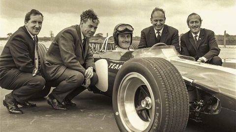 Thumb from left  maurice philippe  keith duckworth  graham hill  mike costin  colin chapman. photo courtesy ford motorsports
