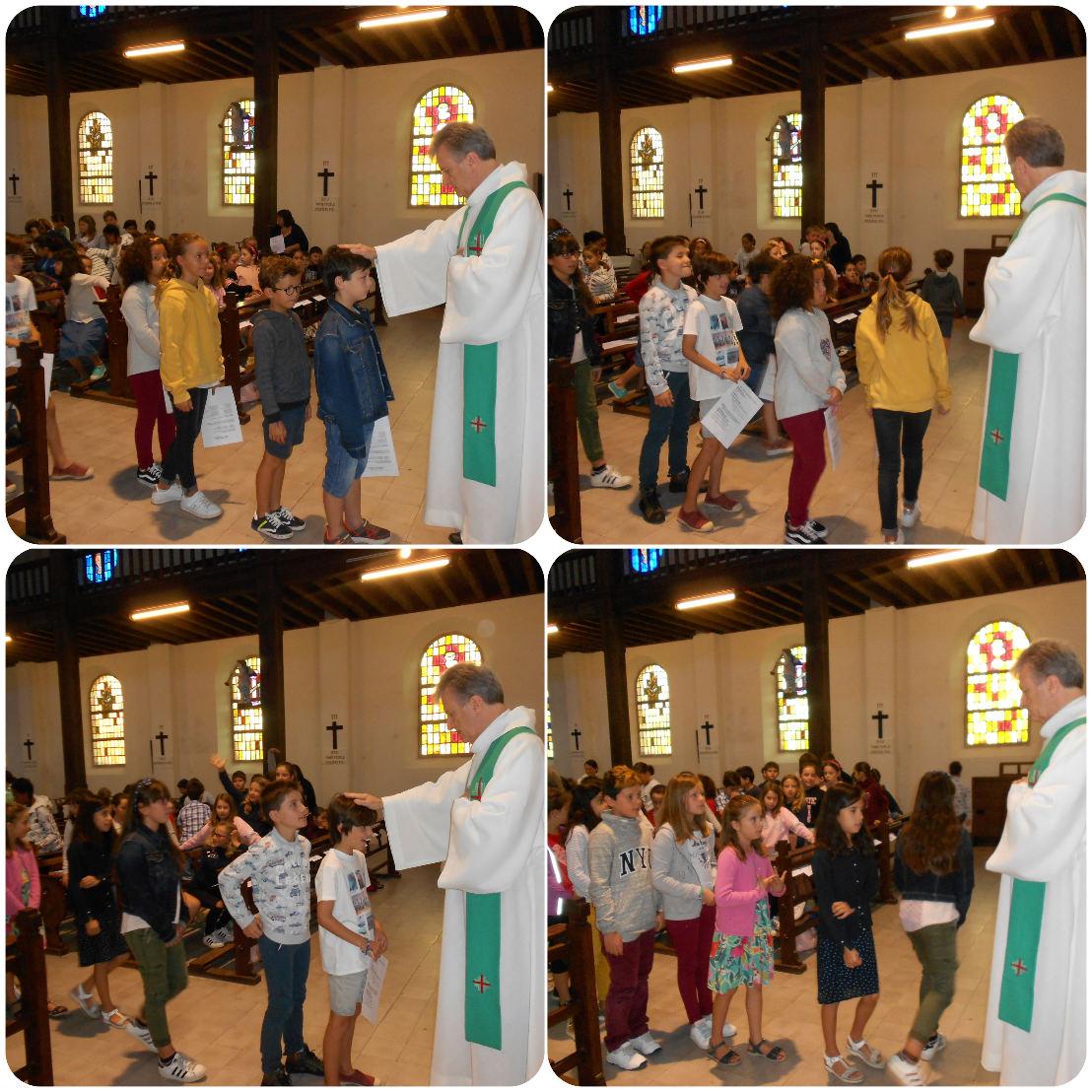 Un par un, les enfants ont été accueillis et bénis par le prêtre au nom de Jésus