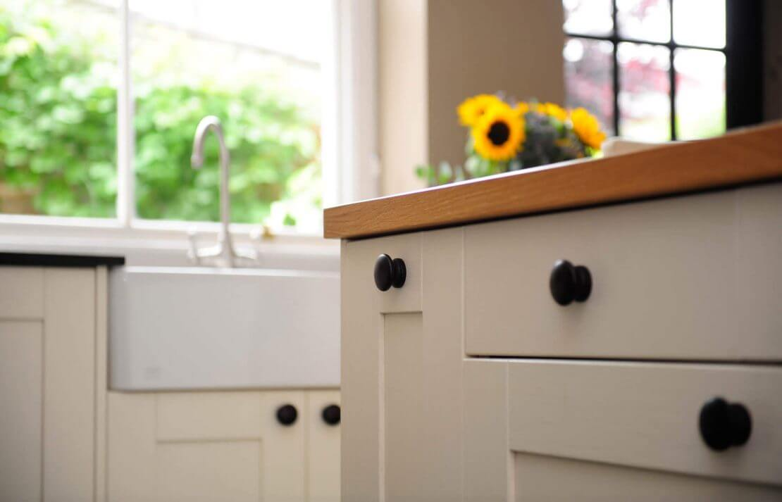 new shaker kitchen with feature kitchen island and belfast sink