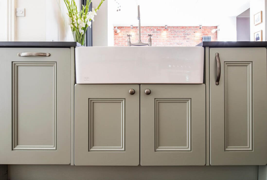 cabinets and double belfast sink in new kitchen