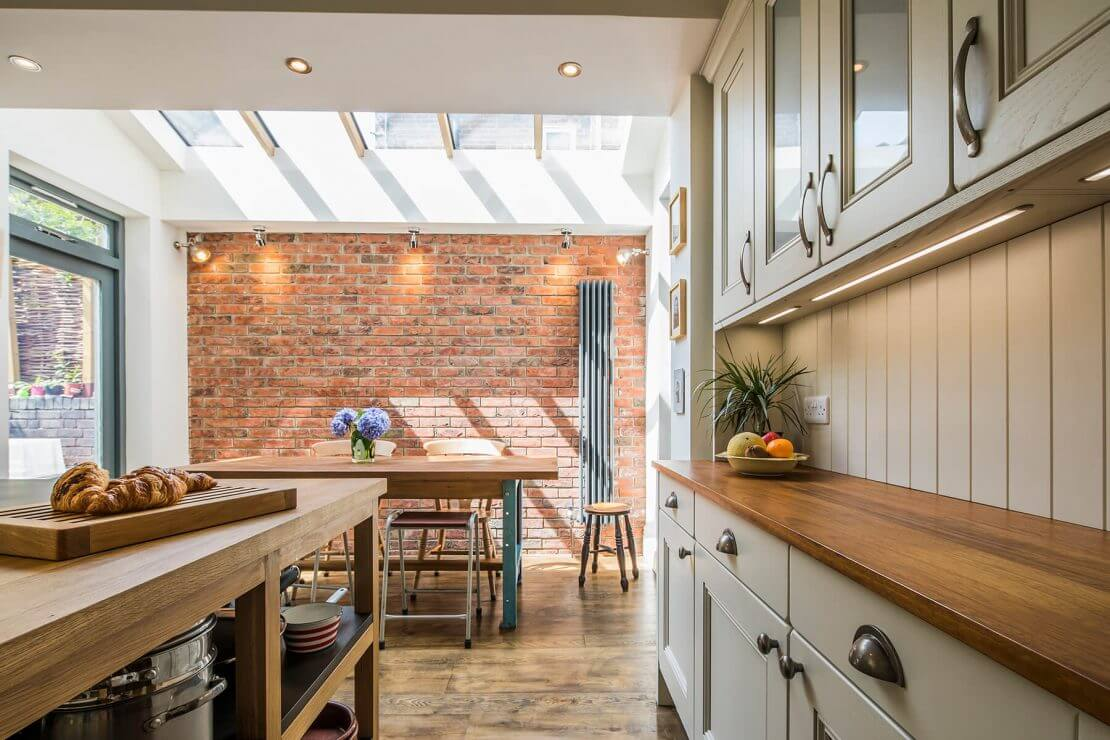 new kitchen with exposed brickwork