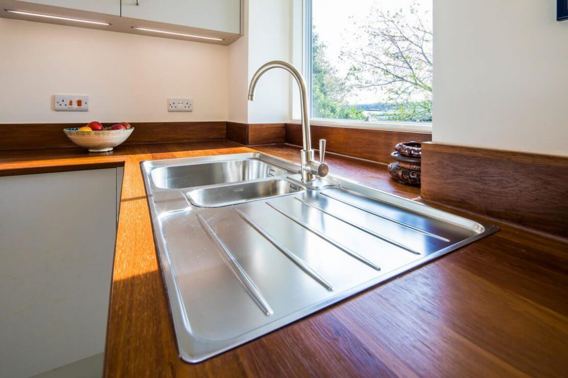 stainless steel sink and tap in reclaimed iroko worktop