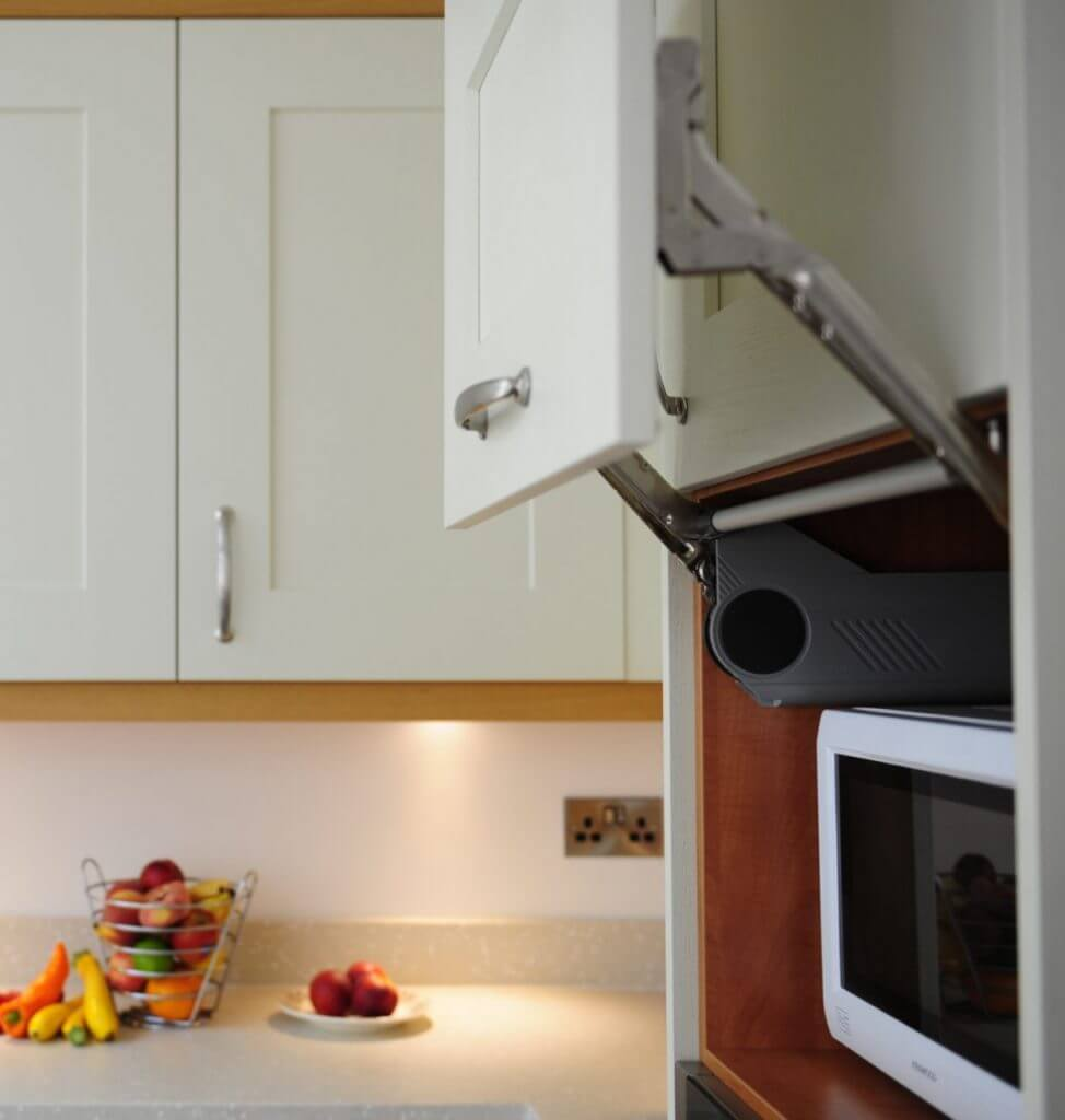Open cupboard revealing concealed microwave