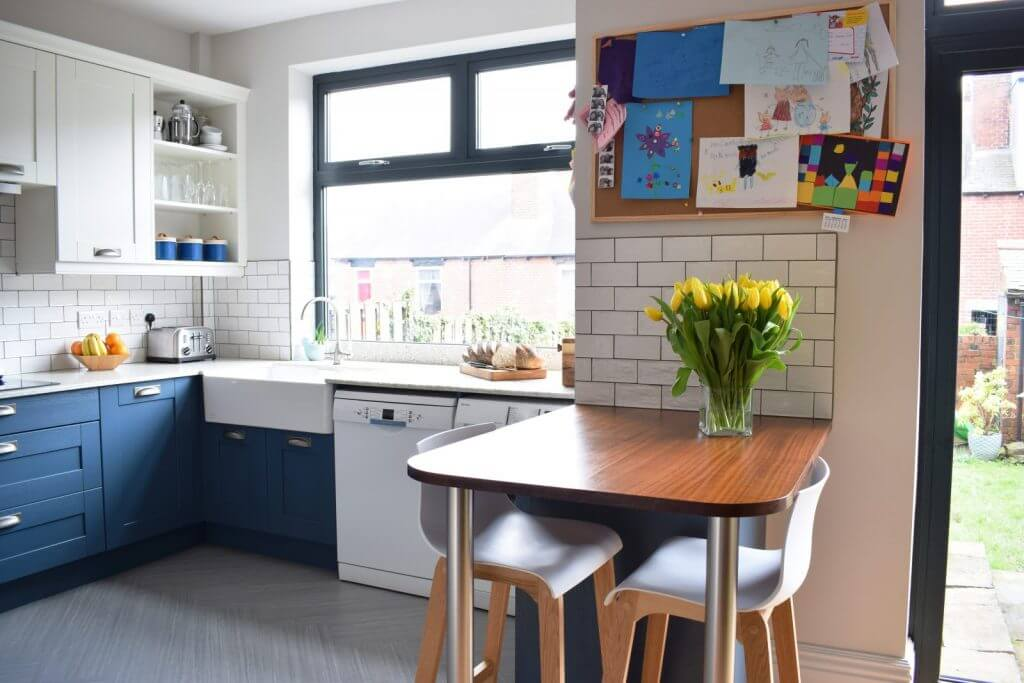 Norfolk blue shaker kitchen with breakfast bar with reclaimed iroko timber top