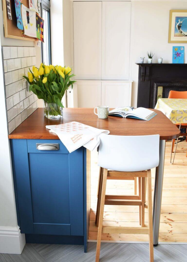 mini breakfast bar with solid iroko worktop and blue kitchen cabinet