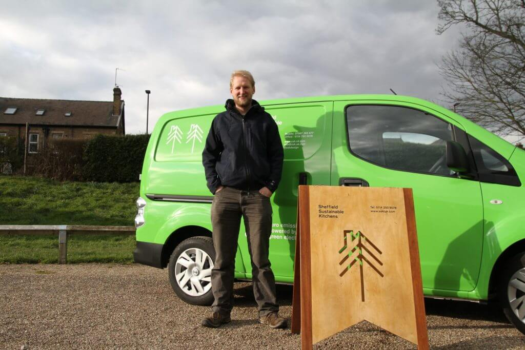 MD and green Sheffield Sustainable Kitchens electric van outside with A board