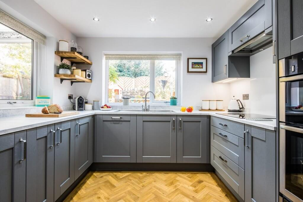 grey shaker u-shaped kitchen with white worktop