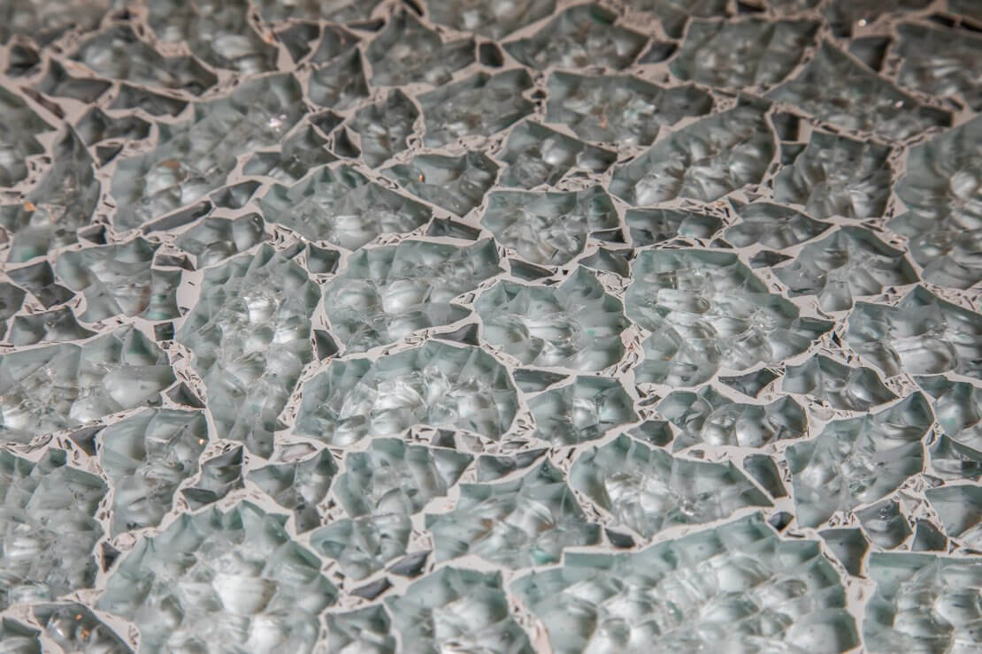 recycled glass worktop in bespoke new large u-shaped kitchen