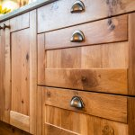 solid wood handmade cupboard doors in bespoke new large u-shaped kitchen
