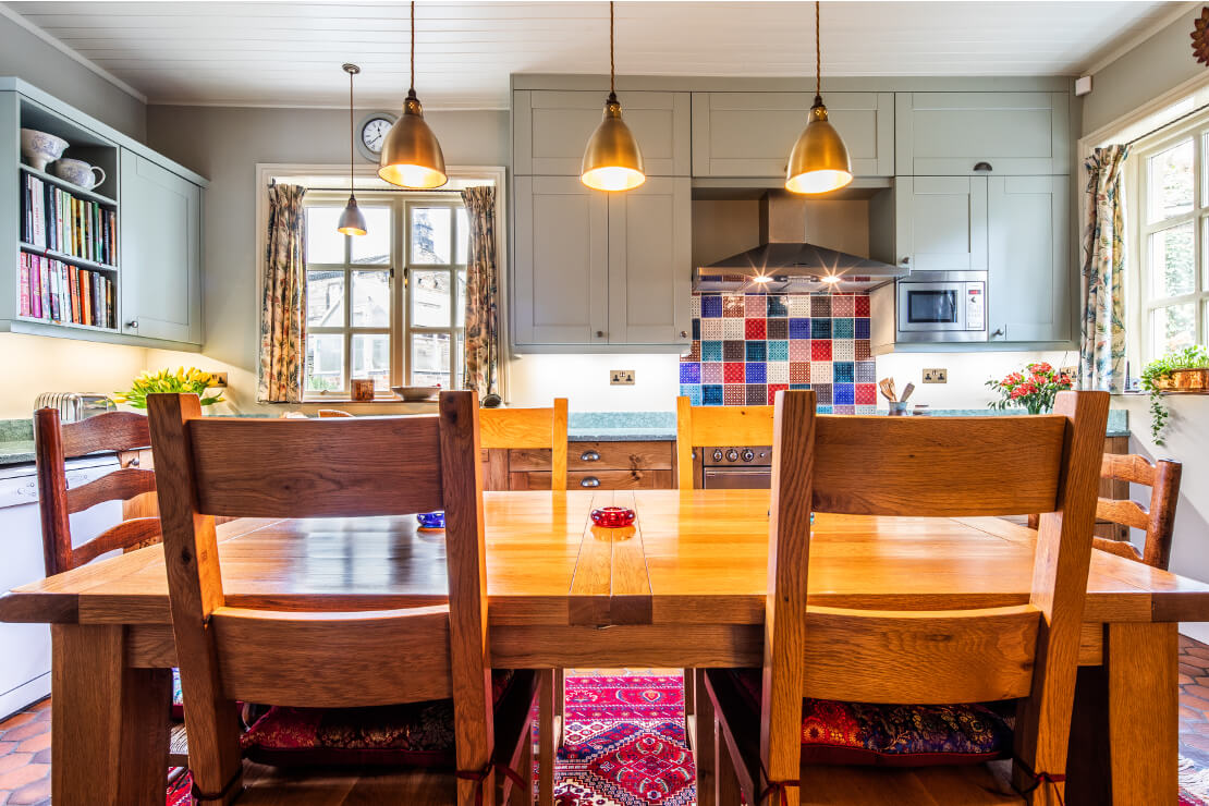 bespoke new large u-shaped kitchen with handmade solid oak doors and recycled glass