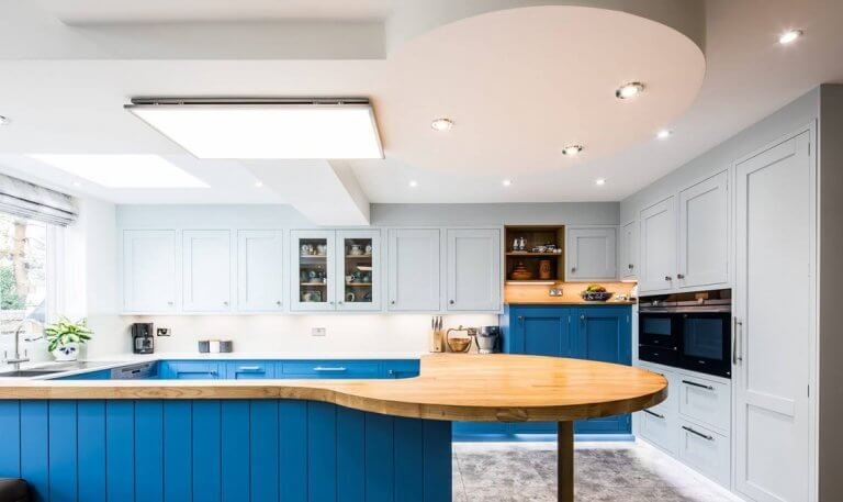 in-frame shaker blue kitchen with breakfast bar