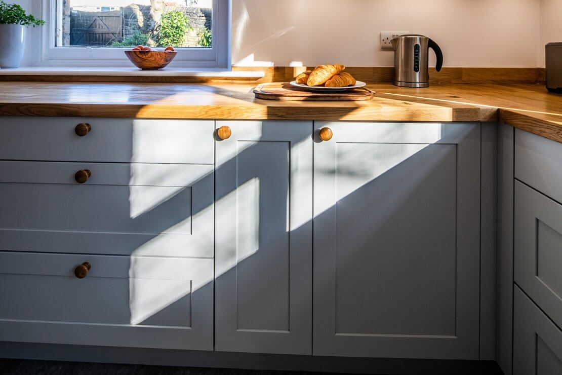 shaker cabinet cupboards in new u-shaped kitchen