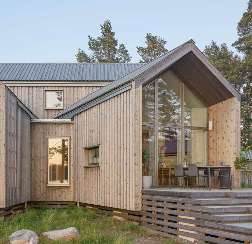edificio in legno nel verde | casa in legno