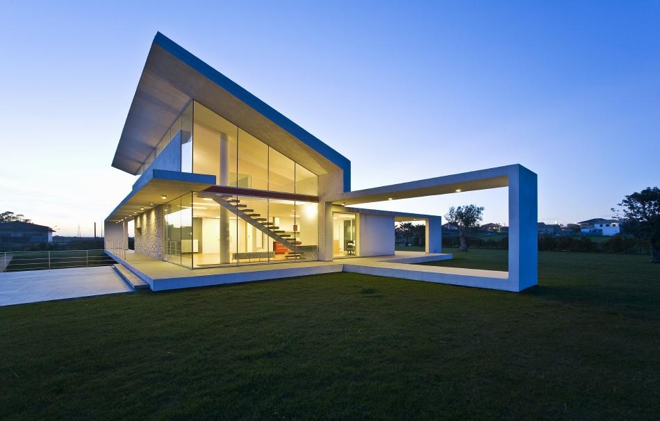 Il moderno che convive con il territorio la villa t for Ville stile moderno
