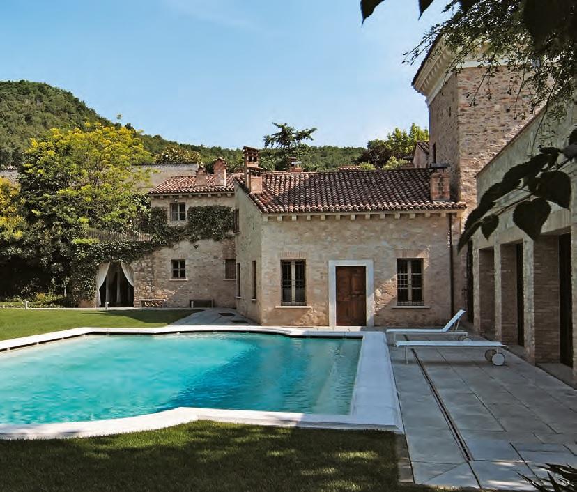 Case rivestite di pietra design casa creativa e mobili for Foto ville in pietra