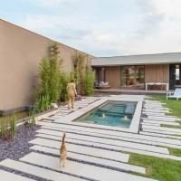 Villa immersa nel verde: raffinato rigore