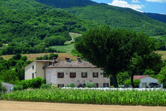 Fossombrone, Italy - July 5, 2017: Rural landscape at summer along the road from Urbino to Fossombrone (Marches, Italy). Farm house