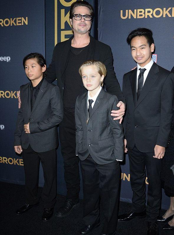 Брэд Питт с сыновьями и дочкой Шило